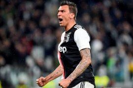 Mandzukic memikul beban patahkan kutukan nomor sembilan Milan