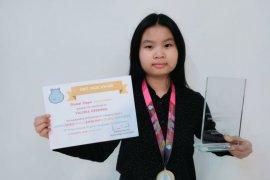 Kerensia  pelajar  Indonesia pertama raih medali emas dalam  Olimpiade Bahasa Inggris