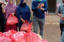 NasDem Sulteng bagikan 2.000 paket pangan di Sulbar