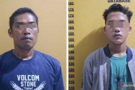 Polisi ringkus dua bandar togel sedang merekap data