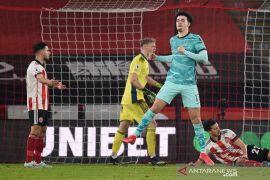 Liverpool akhirnya menang lagi setelah tundukkan juru kunci Sheffield 2-0