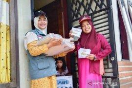 Dompet Dhuafa Singgalang-PKH Luhak Nan Duo Pasaman Barat berbagi bersama di pasar