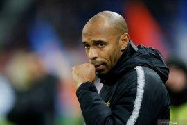 Thierry  ungkap impiannya latih Barcelona dan Arsenal