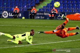 Pemain Atletico Moussa Dembele dikabarkan pingsan saat latihan