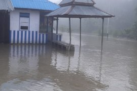 Jalan Trans Papua  poros Jayapura-Keerom terputus karena banjir