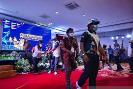 "Peserta CdM Meeting II PON Papua gelar aksi \""eba mokai\"" untuk  korban bencana NTT"