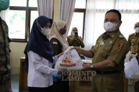 Pemkab Lampung Barat salurkan 14.000 paket sembako untuk ASN dan THLS