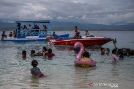 Isi libur lebaran dengan wisata pantai di Tanjung Karang Page 1 Small