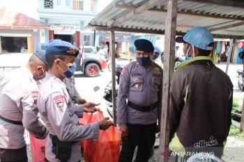 Brimob Maluku bakti sosial terkait COVID-19 di Kabupaten Seram Bagian Barat