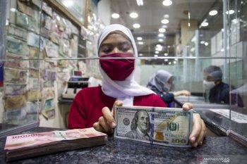 Dolar melemah di tengah optimisme hati-hati sekitar paket fiskal AS