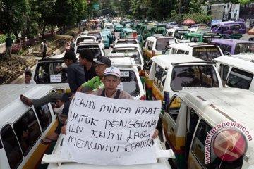 Mencari keselarasan taksi online dan konvensional