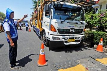Penertiban dan perawatan truk dongkrak bisnis angkutan