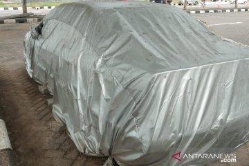 Satu unit mobil terparkir empat tahun di Bandara Ngurah Rai