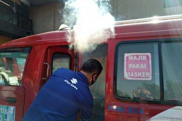 Suzuki semprot disinfektan 1.101 angkot Jakarta