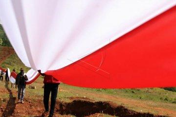 Pembentangan Bendera Merah Putih pada Hari Sumpah Pemuda