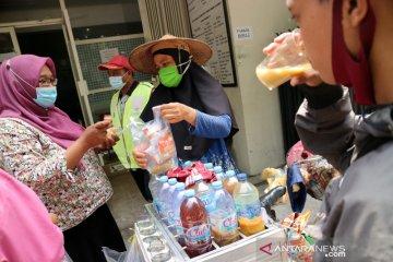 Penjual jamu keliling terapkan protokol kesehatan