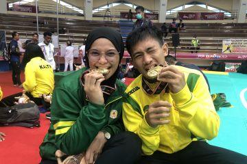 Pasangan suami istri Iqbal-Sarah raih emas pencak silat PON Papua