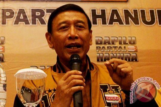 Wiranto Mencoblos di TPS Bambu Apus