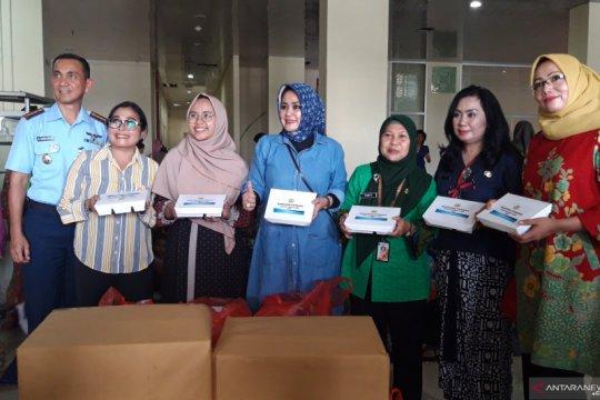 Persatuan Istri Angkatan udara bantu logistik pangan bagi korban banjir