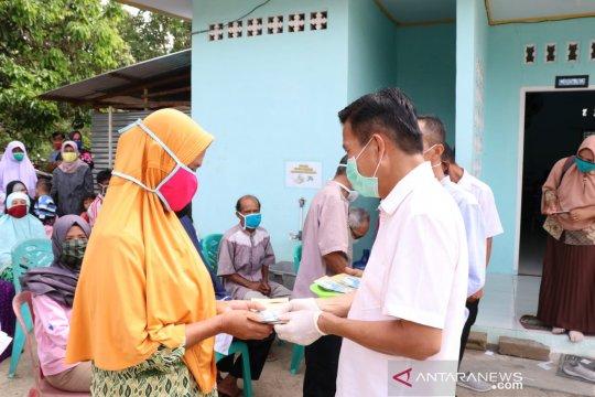 Bupati Bangka Tengah Pantau Penyaluran BLT di Sembilan Desa