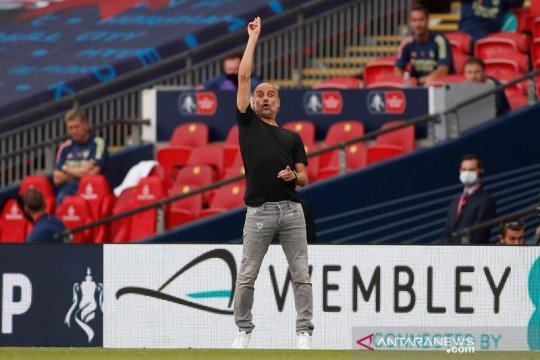 Pep Guardiola mengaku tertantang menyongsong musim kelima bersama City