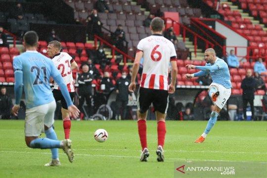Tanpa penyerang murni, Manchester City menang tipis atas Sheffield United