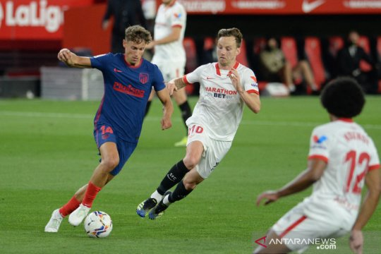 Atletico Madrid gagal meraih tiga poin penting saat kalah dengan skor tipis 0-1 di markas Sevilla