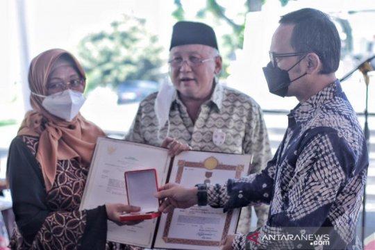 Presiden Jokowi anugerahkan Satya Lencana kepada 16 keluarga pejuang PETA