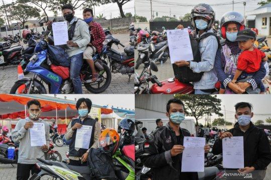 Tes cepat antigen bagi pemudik motor arus balik di Cikarang, Bekasi