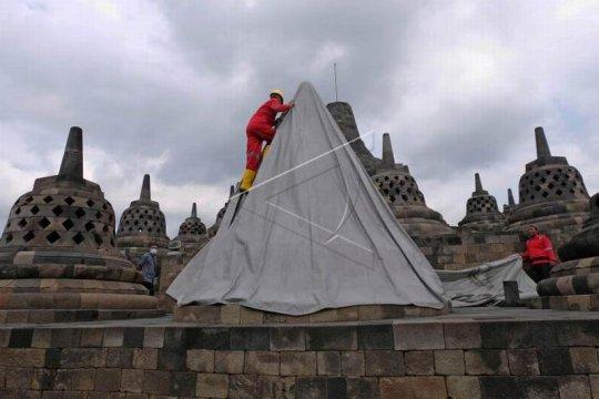 Pembukaan terpaulin penutup stupa Candi Borobudur Page 2 Small