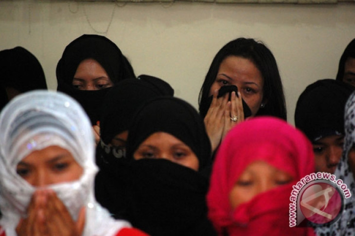 Malaysia deports 153 RI migrant workers