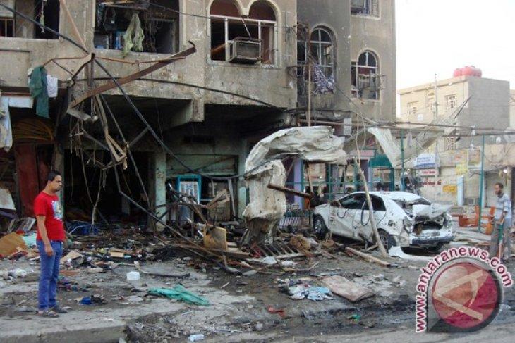 String of Iraq car bomb blasts kill at 17