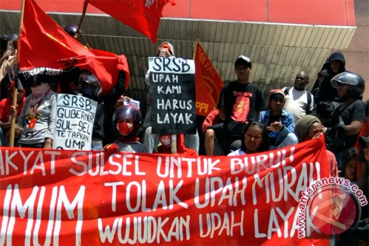 Workers reject 15 pct wage increase proposal