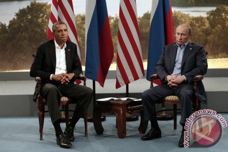 Putin tells Obama Crimean vote complies with international law