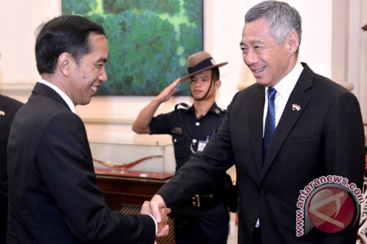 President Jokowi witnesses signing of Indonesia-Singapore agreements