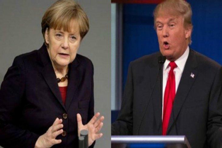 Trump, Merkel agree NATO members must pay fair share