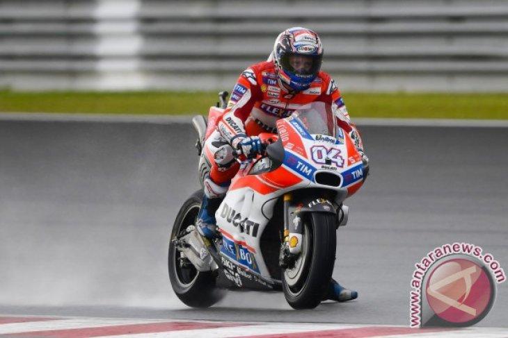 Andrea Dovizioso rajai lintasan basah GP Valencia