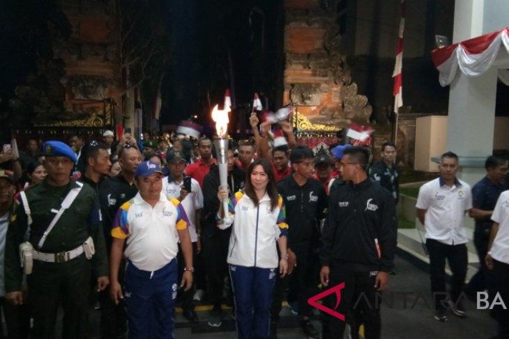 Di Tampaksiring, obor Asian Games disambut