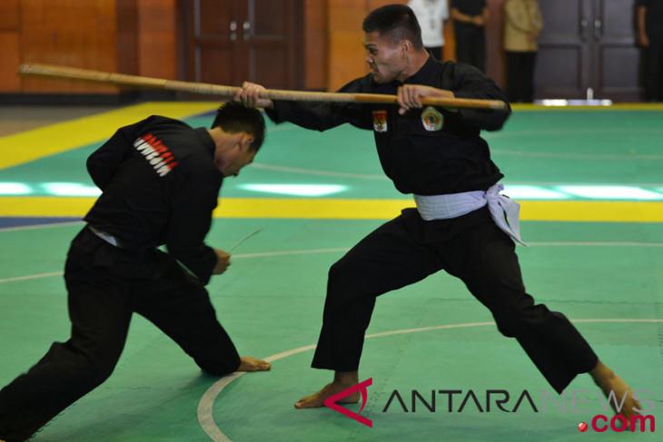 Asian Games (pencak silat) -  Abdul Malik of Indonesia beats Laos 5-0