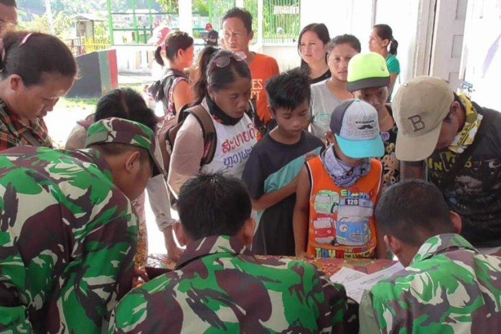 Bhakti sosial pengobatan massal di perbatasan Indonesia - Malaysia