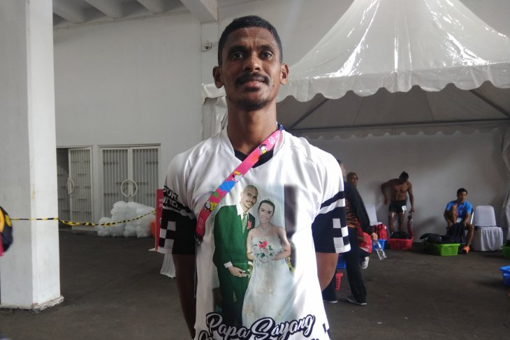 Love for wife motivates Kolymau to win medal