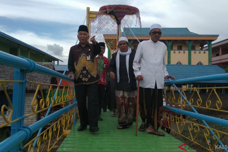 Pemangkih residents have a cable stayed bridge