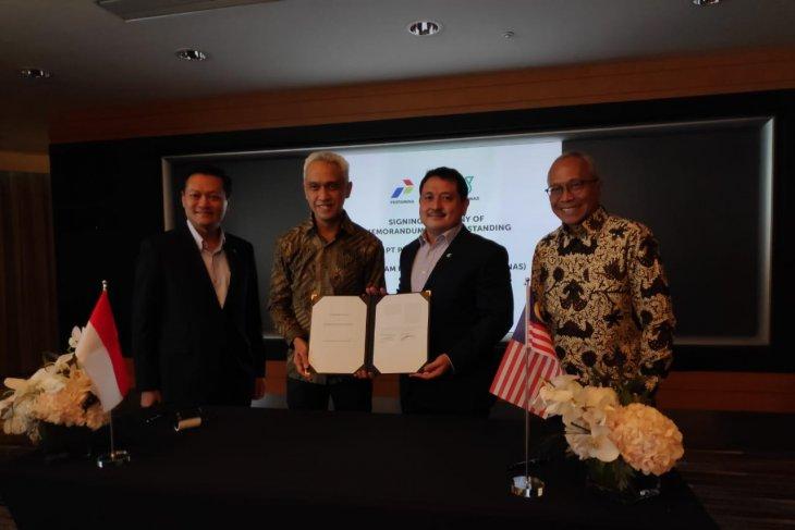 Pertamina, Petronas sign MoU on business development