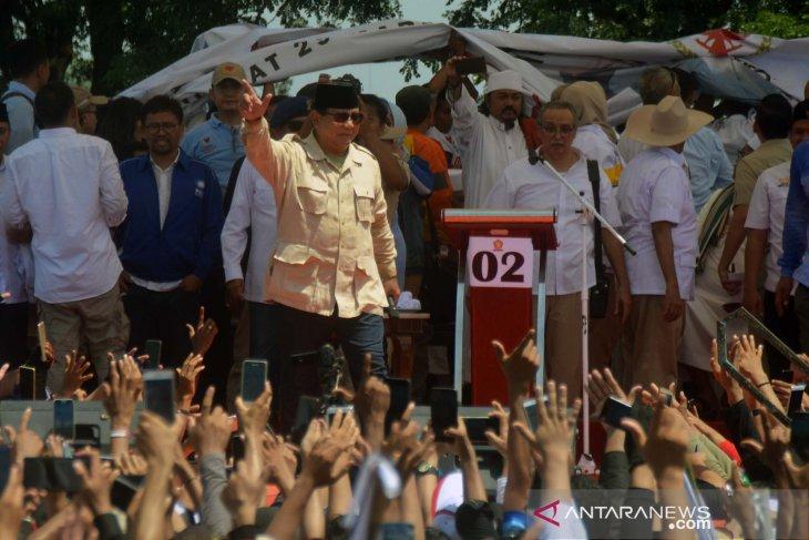 Prabowo Subianto greets journalists covering his campaign in Karawang