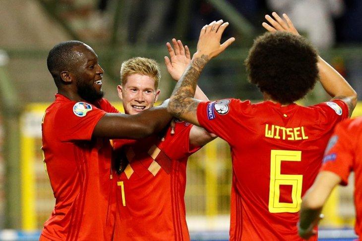 Belgia kokoh puncaki  Grup I