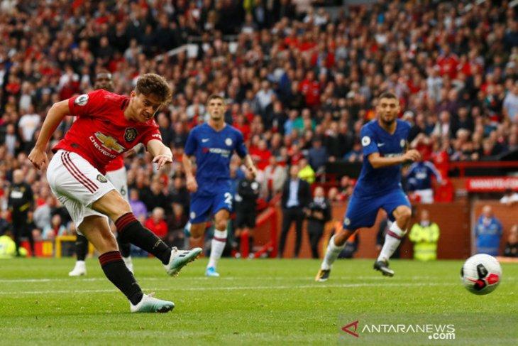 Neville sesumbar MU bakal juara lagi sebelum Liverpool meraihnya