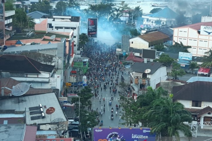 Security personnel fire tear gas to diffuse rioters in Papua