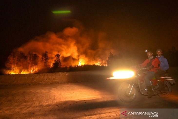 Satellites detect 1,211 fire hotspots throughout Sumatra