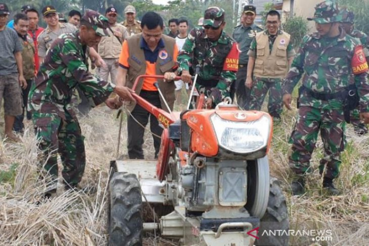 Hand tractor modification a solution to avoid land fire in HSS
