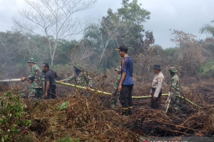 Firefighters attempt to extinguish fire in West Aceh